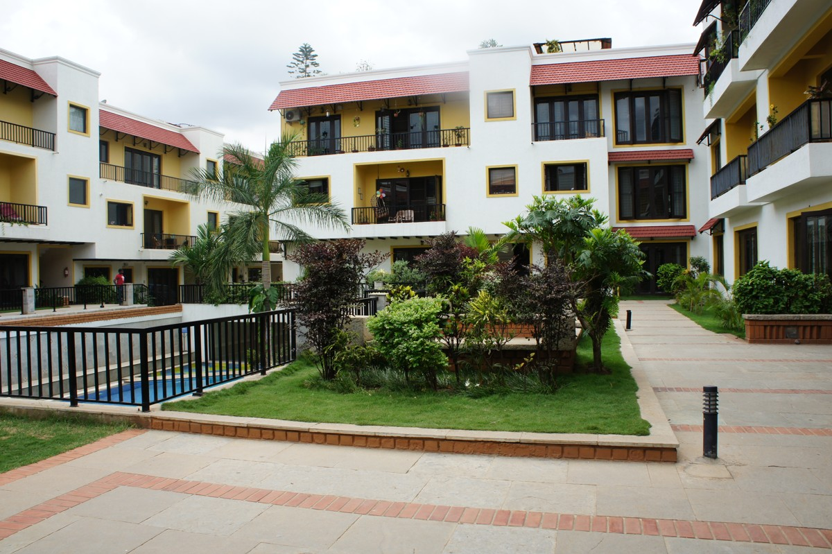 Outdoor seating arrangements at Waterwoods Apartments, Bangalore