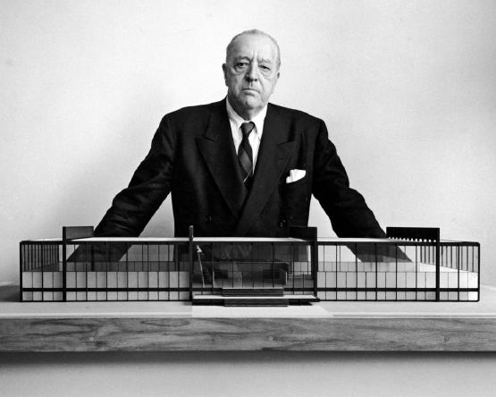 Mies with a model of his masterpiece