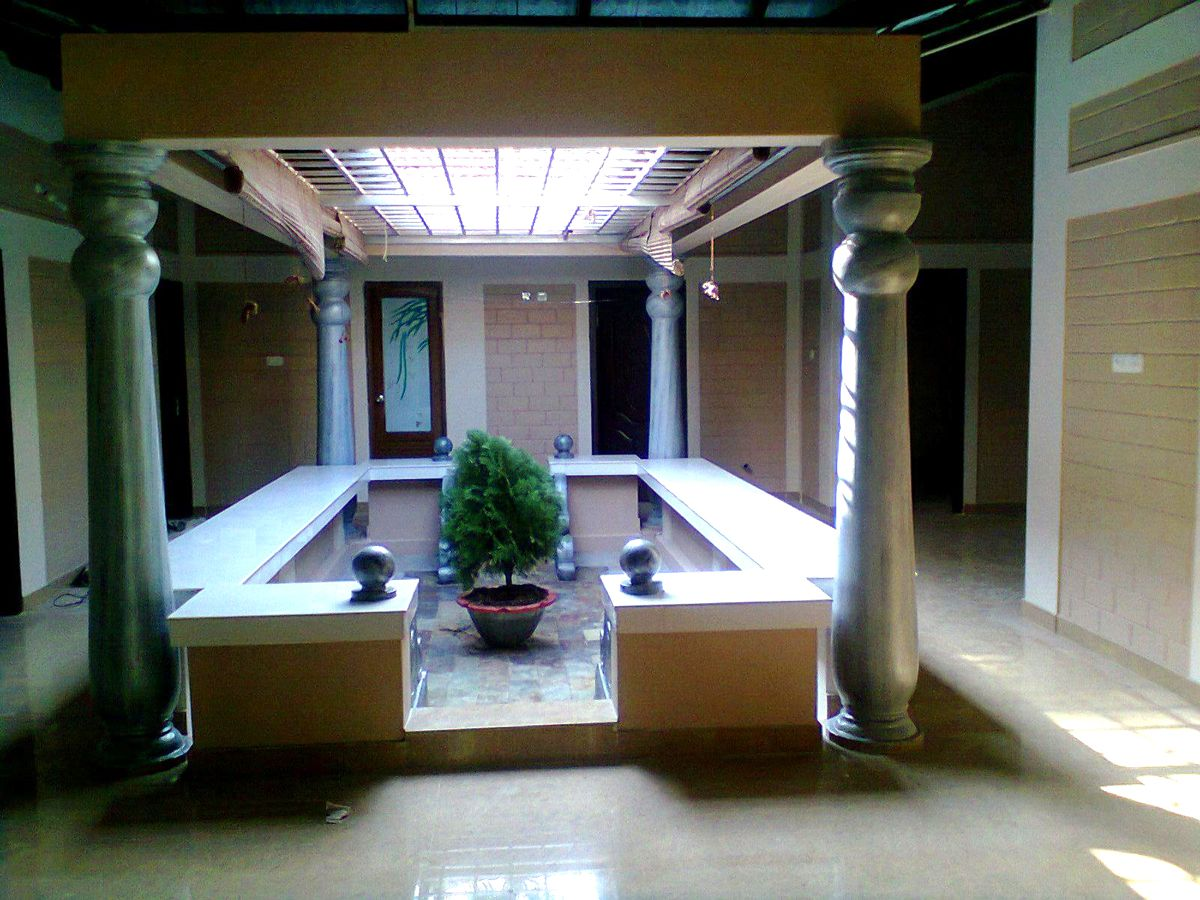 Interior designing done in kerala style interior for Traditional house designs in tamilnadu