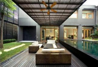A modern Courtyard with a pool and seating
