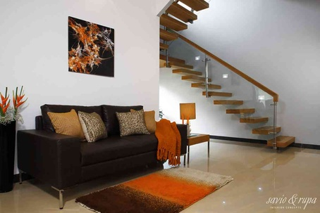 Living area and cantilevered staircase