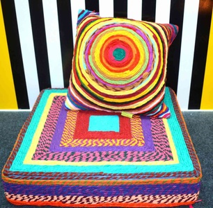 Pillow made of colourful recycled fabric ropes
