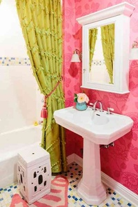 Pink wallpaper on one of the walls