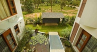 Vijayan Residence Exteriors - Pond in the middle