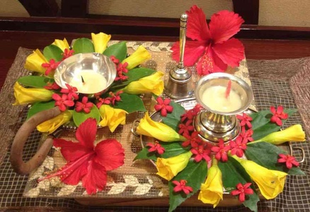 Puja Thali With Diyas Decorated With Flowers