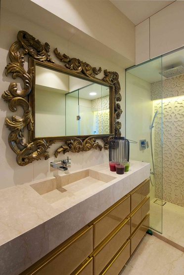 Grand carved mirror frame with golden cabinets