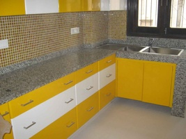 Yellow Kitchen with Granite Countertop