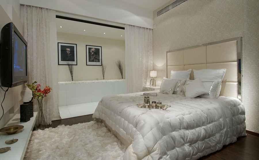 White Master Bedroom with Hardwood floors