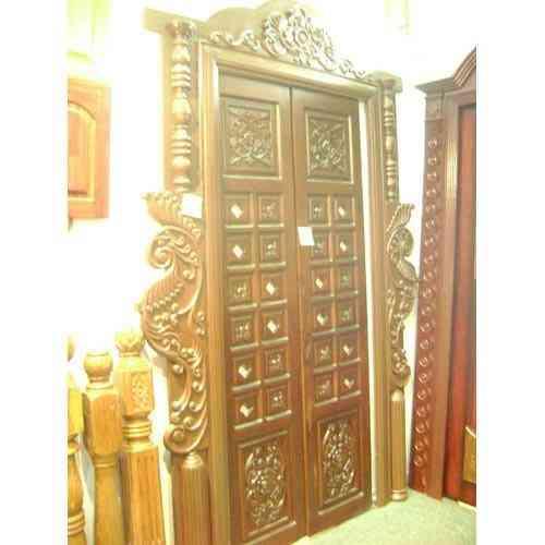 Pooja room door design photos pictures door designs for for Room wooden door design